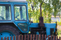 Blue farm tractor. In forest Royalty Free Stock Image