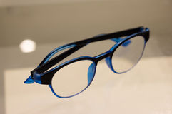 Blue fashion glasses on glass, side view Royalty Free Stock Photo