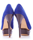 Blue fashion high heeled woman shoes. Back picture of a pair of blue fashion high heeled woman shoes on white background Royalty Free Stock Photos