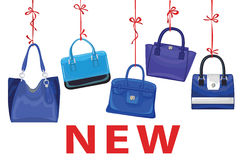 Blue fashion women's handbag hang on ribbon.New Stock Photography