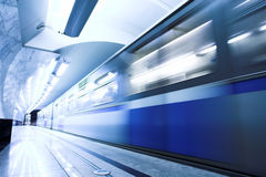 Blue fast train stay at platform Stock Photo