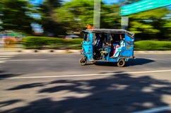 Fast Blue Tuk Tuk. A tuk tuk a.k.a auto rickshaw in motion Royalty Free Stock Photo