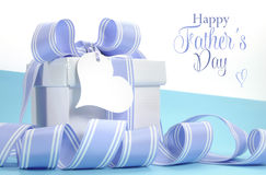 Blue Fathers Day gift with beautiful stripe ribbon and heart shape gift tag Royalty Free Stock Image