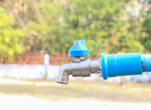Blue the faucet. The faucet in a park in Rural of Thailand Royalty Free Stock Photography