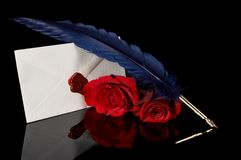 Blue feather and red roses Stock Photography