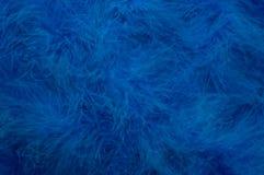 Blue Feathered Background. Background blue fluffy feathered boa stock images