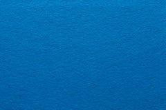 Blue felt texture background solid color paper. Blue felt texture abstract art background. Solid color construction paper surface. Empty space stock image