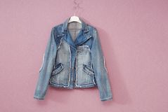 Blue female denim jacket Stock Images