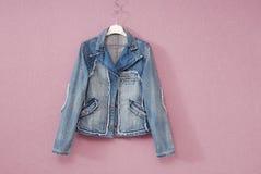 Blue female denim jacket stock images