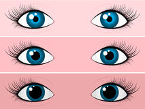 Blue female eyes - bright and dark Stock Images