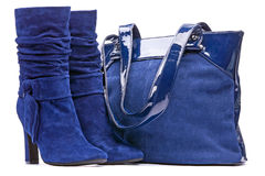 Blue female suede boots and bag. On the white background Stock Photos
