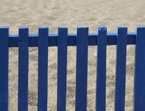 The blue fence. On the beach stock photography