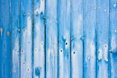 Blue fence panels. Part of a weathered blue fence as a background Royalty Free Stock Photography