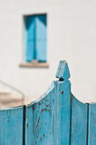 Blue fence and windows Stock Image