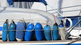 Blue fenders. Some blue fenders on the boat Royalty Free Stock Photography