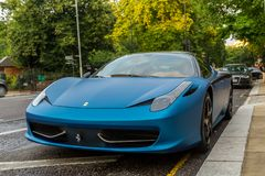 Blue Ferrari 458 parked in street in London. Landscape photograph Stock Photo
