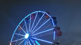 Blue Ferris Wheel. A blue lighted ferris wheel at dusk.  Theme park picture Stock Photography