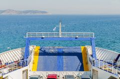 Blue ferry boat for transport of people and cars stock photos