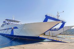 Blue ferryboat for the transport of people and cars Royalty Free Stock Images