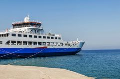 Blue ferryboat for the transport of people and cars Stock Image