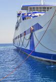 Blue ferryboat for the transport of people and cars Stock Photo