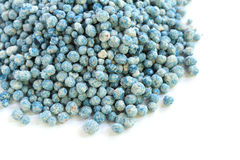 Blue fertilizer. Pile of blue fertilizer on white background Royalty Free Stock Photography