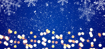 Blue festive Christmas background. Blue festive Christmas or New Year background with shiny golden baubles Stock Images