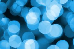 Blue Festive Christmas elegant abstract background with many bokeh lights. Defocused artistic image.  Royalty Free Stock Images
