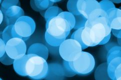 Blue Festive Christmas elegant abstract background with many bokeh lights. Defocused artistic image stock photography