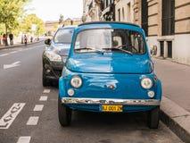 Blue Fiat parked on a Paris street on Ile de la Cite Stock Photos