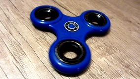 Blue fidget spinner stock footage