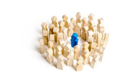 Blue figure leader stands at the head of the crowd. Business concept of leader and leadership qualities. Crowd management. cooperation and meeting royalty free stock image