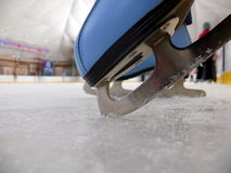 Blue figure skate in the ice Royalty Free Stock Image