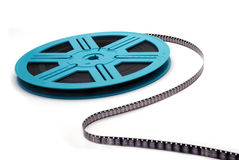 Blue Film Reel S-Curve. An old-fashioned film reel unrolling, isolated on white Royalty Free Stock Image