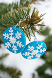 Blue fimo earrings with snowflake model Stock Image