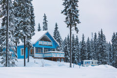 Blue Finnish house in winter forest Stock Photo