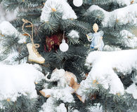 Blue fir-tree is decorated by Christmas toys. Elephants, angel, Royalty Free Stock Images