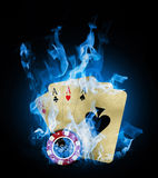 Blue fire. Old vintage cards and a gambling chip Stock Photography