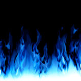 Blue fire from edge of image / black background. Stock Photo