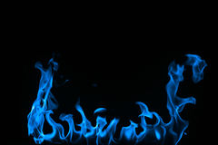 Blue Fire isolated on a black background. royalty free stock image