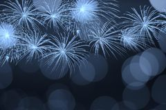 Blue firework and blurred bokeh light with copy space in Christmas and New Year. Abstract background holiday concept. Blue firework and blurred bokeh light with stock illustration