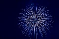 Blue firework explosion. During holiday celebration stock image