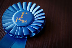 Blue first place winner rosette Stock Images