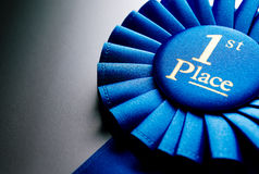 Blue first place winner rosette Stock Image