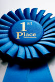 Blue first place winner rosette Royalty Free Stock Photography