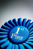 Blue first place winner rosette Stock Photo