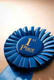 Blue first place winner rosette Royalty Free Stock Images