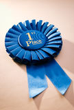 Blue first place winner rosette Stock Photography