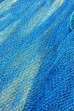 Blue fish net background Royalty Free Stock Photography