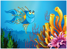 A blue fish under the sea near the coral reefs. Illustration of a blue fish under the sea near the coral reefs on a white background Stock Image